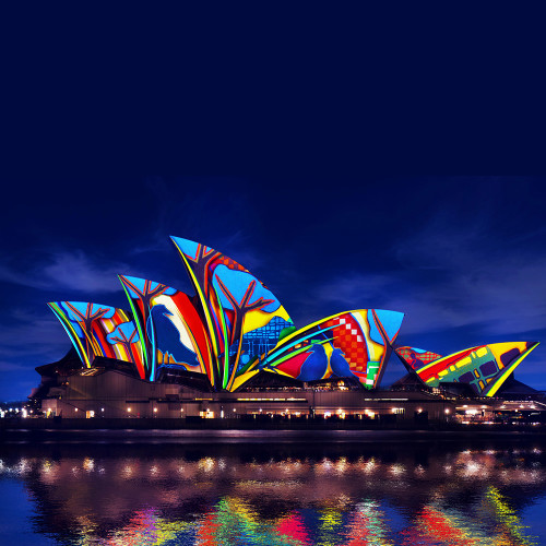 An image of the Sydney Opera House lit up for Vivid light festival on your private tour with a sydney architect