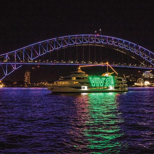 An image of the Sydney Opera House lit up for Vivid light festival on your private tour with a sydney architect, courtesy of Destination NSW